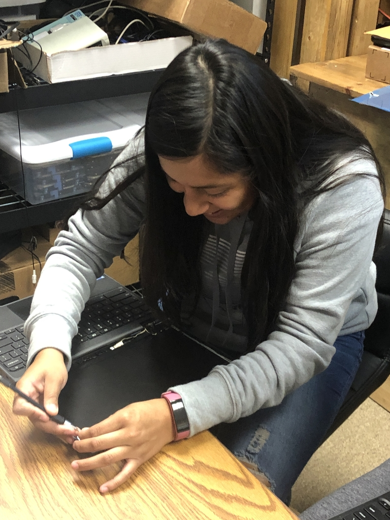 Student intern replacing a Chromebook screen